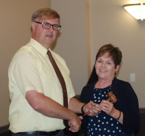 Peterson receiving gavel from Stroeder